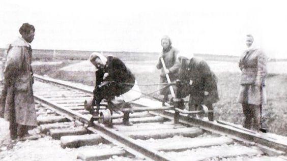 women building a railway